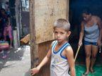 PHOTOS: फोटोग्राफरने दाखवली रेड लाइट एरियामधील महिला-मुलांची अशी LIFE| - Divya Marathi
