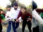હેલમેટ વગર ડ્રાઈવ કરતા કપલને પકડ્યું ટ્રાફિક પોલીસે, ભડકેલી યુવતીએ કરી હાથાપાઈ| - Divya Bhaskar