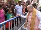રોડ શૉ સમયે અમિત શાહ 'બાળમિત્ર'ને મળ્યા, ગાલ પર હાથ ફેરવી જય શ્રીરામનો નારો લગાવ્યો|ઈન્ડિયા,National - Divya Bhaskar