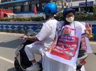 बंगाल की CM ने किया पेट्रोल-डीजल की कीमतें बढ़ने का विरोध, गले में महंगाई का पोस्टर लगाकर ई-स्कूटी से सचिवालय पहुंचीं|देश,National - Dainik Bhaskar