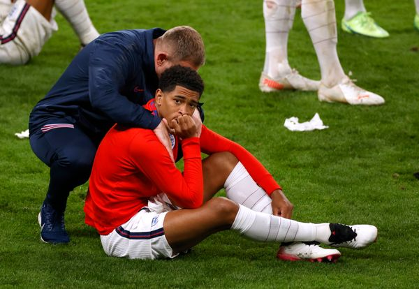 England player Jude sat down on the Bellingham ground in despair.  The match went into a penalty shootout after the match ended in a 1-1 draw.