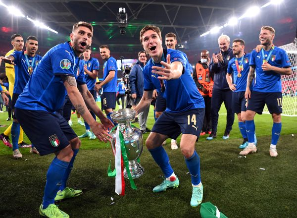 Italian players celebrating with the trophy.