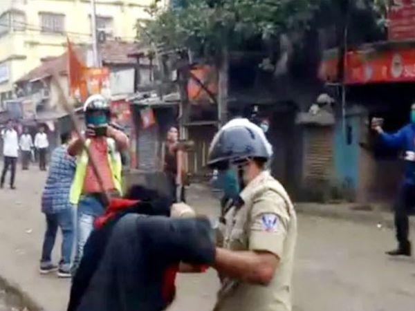 पश्चिम-बंगाल की राजधानी कोलकाता में भाजपा की मेगा रैली के दौरान पुलिस ने सिख बलविंदर सिंह की पिटाई की थी। फोटो इस घटना के वायरल वीडियो से लिया गया है। - Dainik Bhaskar