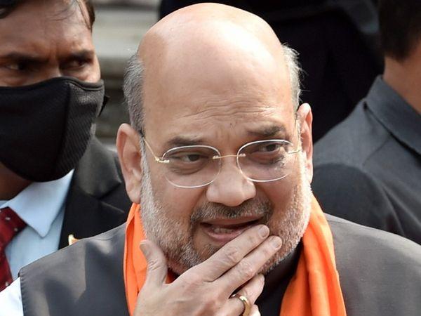 अमित शाह ने अगस्त 2018 में कोलकाता में एक रैली के दौरान ममता सरकार पर भ्रष्टाचार के आरोप लगाए थे। उन्होंने ममता के भतीजे अभिषेक बनर्जी का नाम भी लिया था।- फाइल फोटो। - Dainik Bhaskar