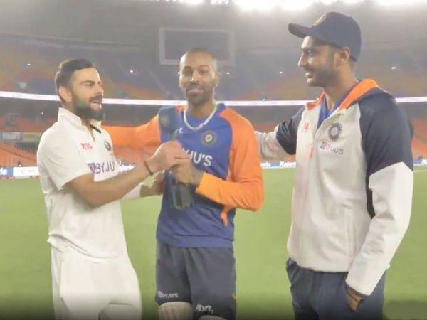 डे-नाइट टेस्ट के बाद ग्राउंड पर भारतीय कप्तान विराट कोहली, हार्दिक पंड्या और अक्षर पटेल। - Dainik Bhaskar
