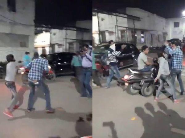 कानपुर में बीच सड़क युवक को पीटती युवती। - Dainik Bhaskar