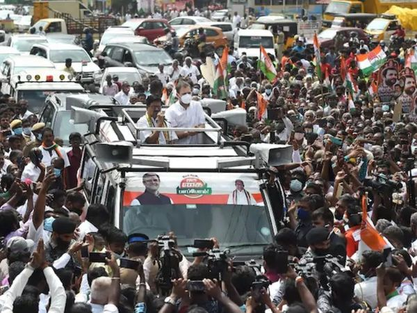 Congress leader Rahul Gandhi performing road show in Coimbatore, Tamil Nadu.  Rahul himself was seen wearing a mask, but most of the people were walking with him without a mask.