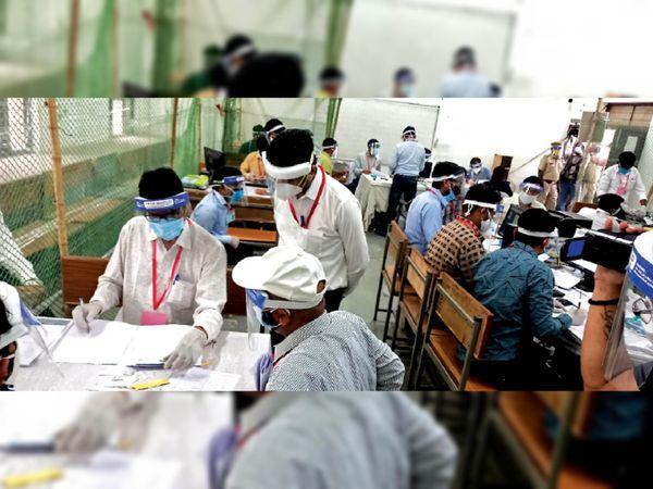 कोरोना गाइडलाइन के कारण मतगणना कर्मचारियों के लिए फेस शील्ड व मास्क लगाना जरूरी था। - Dainik Bhaskar