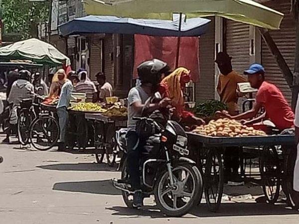 श्रीगंगानगर की सब्जी मंडी में  सब्जियां  बेचते दुकानदार। - Dainik Bhaskar