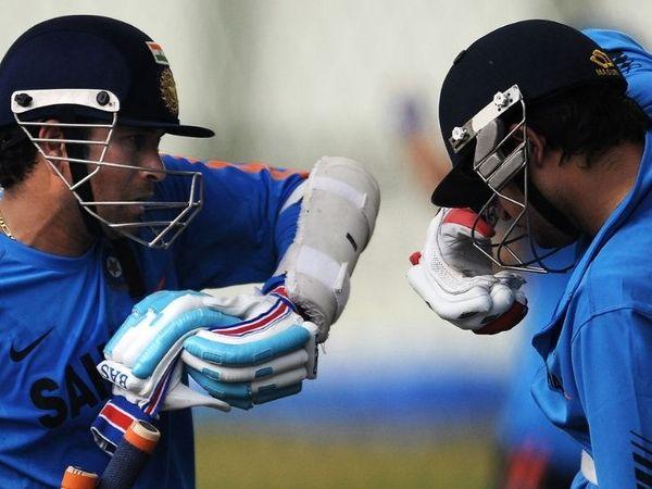 सचिन तेंदुलकर और सुरेश रैना बल्लेबाजी को लेकर बातचीत करते हुए। फाइल फोटो।