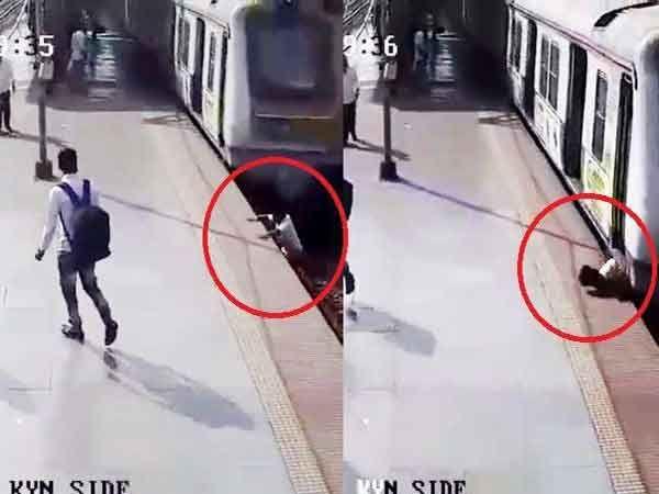 ट्रॅक क्रॉस करताना दरम्यान लोकल ट्रेनमध्ये खाली आलेला युवक.... - Divya Marathi