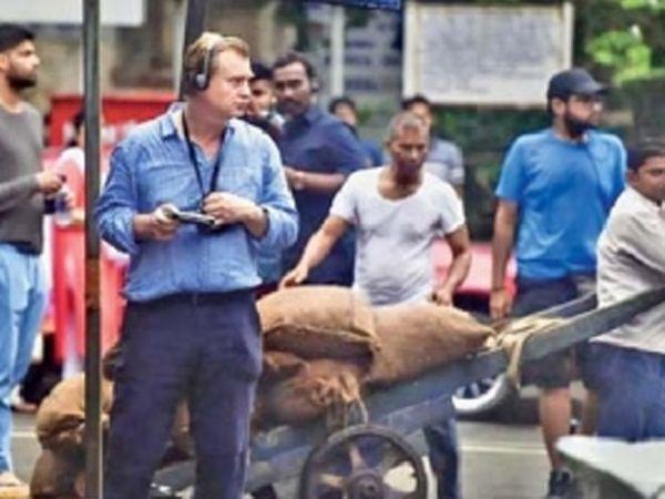 हॉलीवूड चित्रपट टेनेंटचे दिग्दर्शक क्रिस्टोफर नोलन मुंबईत चित्रीकरणाच्या वेळी. - Divya Marathi