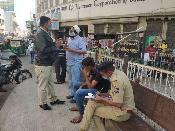 અમદાવાદના બેદરકાર લોકોને દંડનીય કાર્યવાહી કરાઈ રહી છે. - Divya Bhaskar