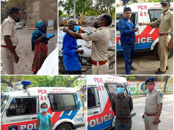 નિરાશ્રીતોને માસ્ક આપી રહેલી પોલીસ