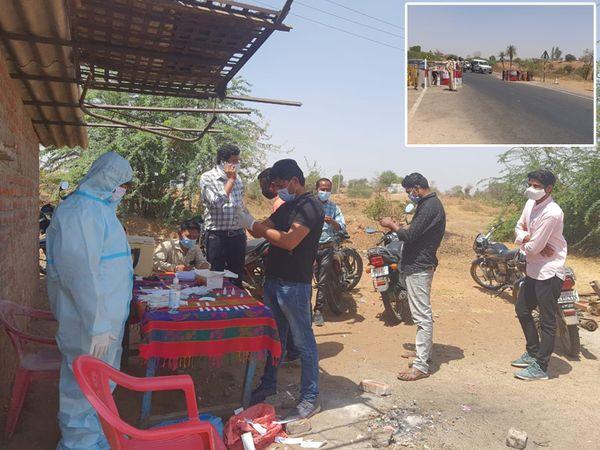 દાહોદ જિલ્લાની બોર્ડર ઉપર જિલ્લામાં પ્રવેશતા લોકોની તપાસ કરતી પોલીસ. - Divya Bhaskar