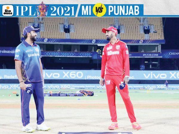 टॉस जीतने के बाद, पंजाब किंग्स के कप्तान राहुल ने गेंदबाजी करने का फैसला किया।  उनके साथ मुंबई के कप्तान रोहित शर्मा (बाएं) खड़े हैं।
