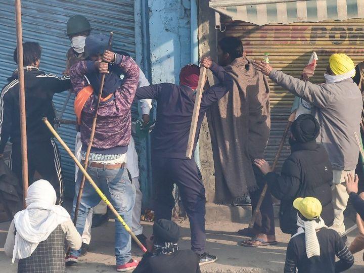किसानों ने मंगलवार को दिल्ली में ट्रैक्टर परेड निकाली थी। इस दौरान कई जगह हिंसा हुई। फोटो में प्रदर्शनकारी एक पुलिसकर्मी से मारपीट करते हुए दिख रहे हैं। - Dainik Bhaskar