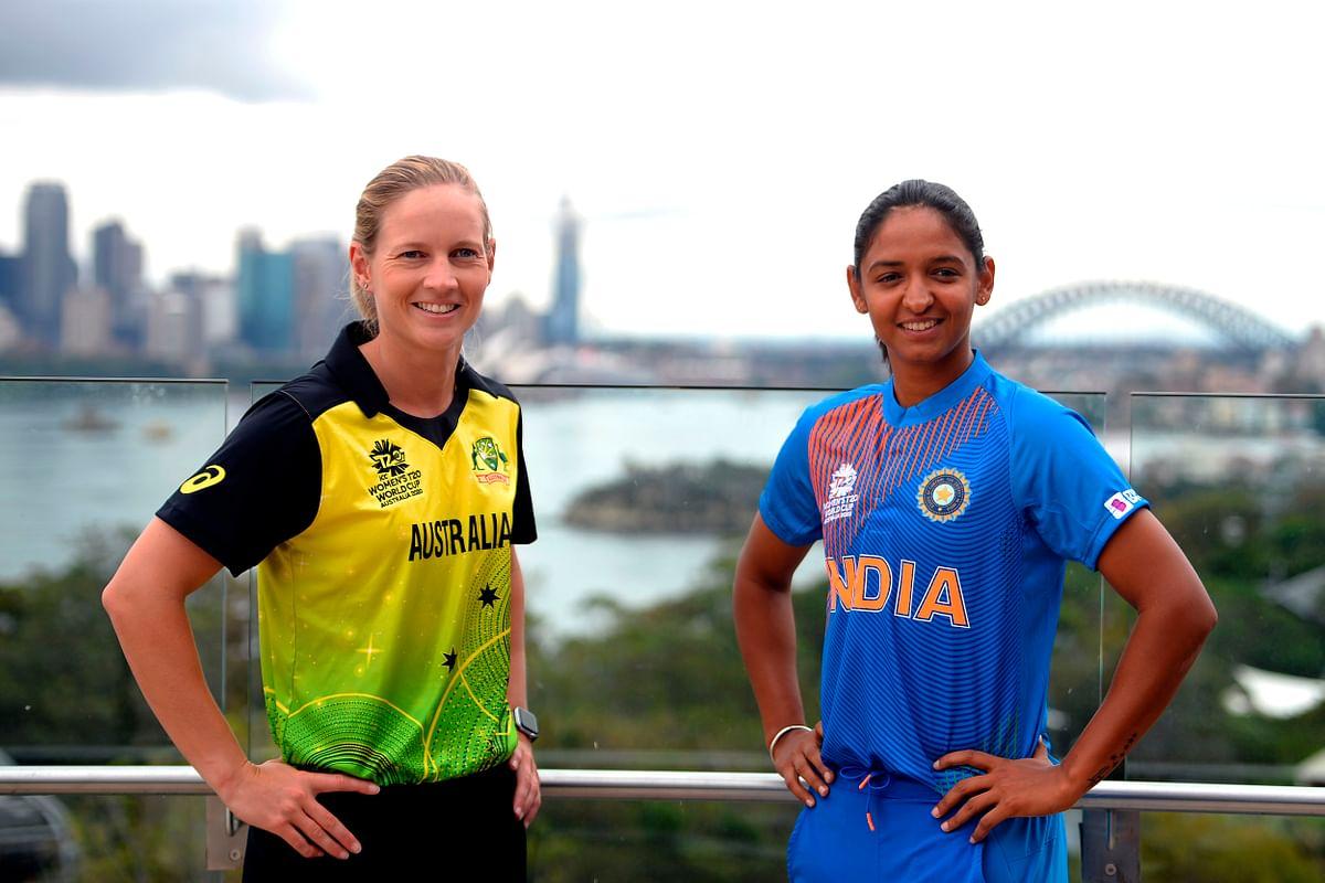 ऑस्ट्रेलियाई महिला टीम की कप्तान मेग लेनिंग और भारतीय कैप्टन हरमनप्रीत कौर (दाएं)। - Dainik Bhaskar
