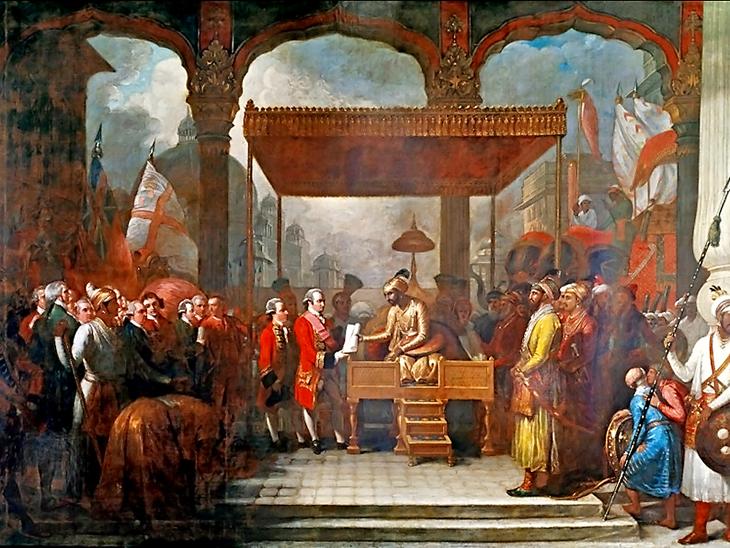 1765 में मुगल शासक शाह आलम ने रॉबर्ट क्लाइव को दीवानी सौंपी थी। इससे ईस्ट इंडिया कंपनी को बंगाल, बिहार और आज के ओडिशा से टैक्स वसूलने का अधिकार मिल गया था। यह पेंटिंग्स बेंजामिन वेस्ट ने 1818 में बनाई है।