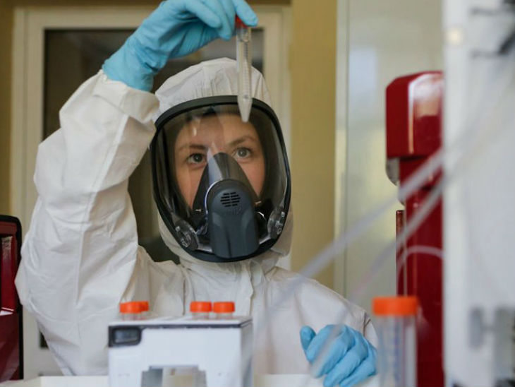 A researcher engaged in research at the Gamalaya Research Institute of Epidemiology and Microbiology, Russia