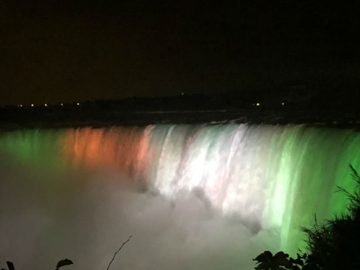 Canada's Niagara Falls and the United States' Empire State Building were lit up with the colors of the tricolor