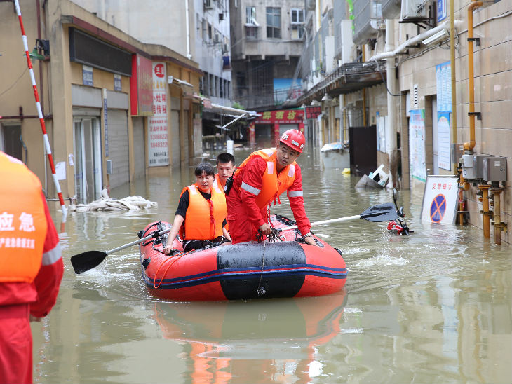 Rescue workers evacuating people in Nejiang, Sichuan province.