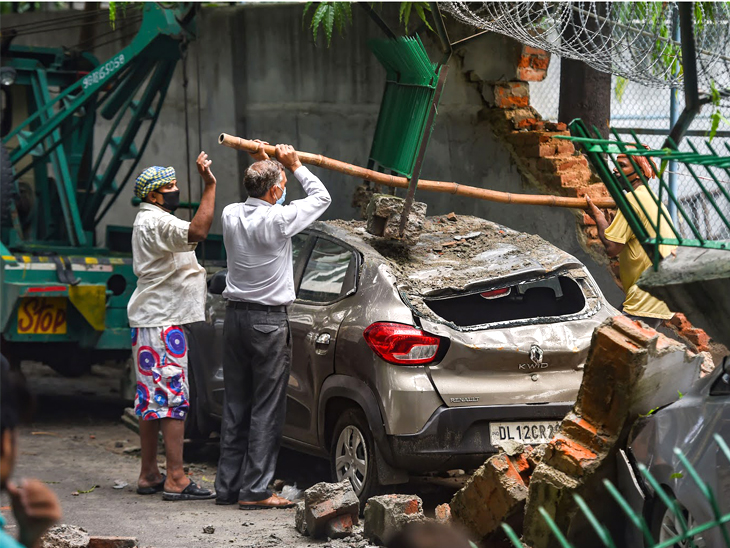 Wednesday's photo is from Saket Nagar in Delhi, where the school wall fell.
