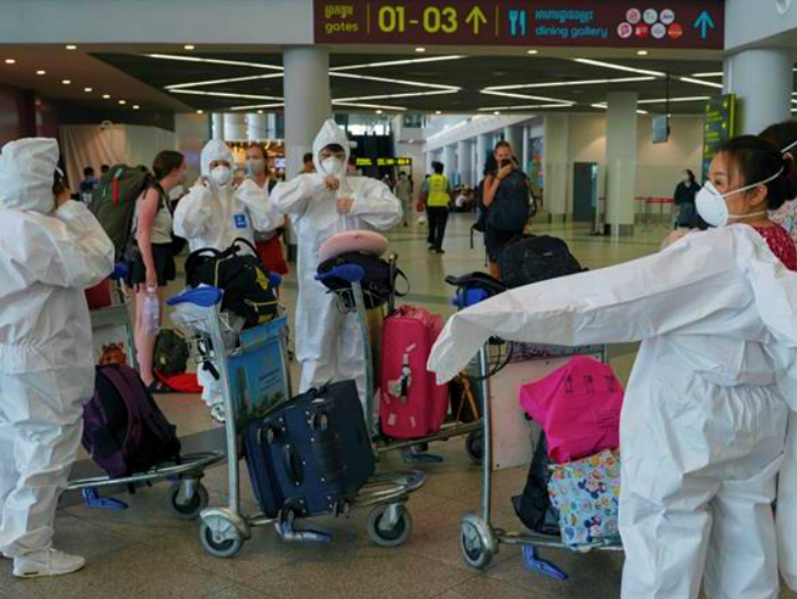 Health workers at Milan Airport preparing for screening wearing PPE kits before a flight arrives. In Italy, the highest number of cases have been found in a single day after 14 May.