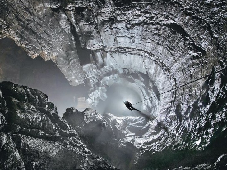 The photo is of the deepest cave in the world located in the Caucasian Mountain of Russia.