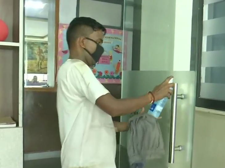 Workers sanitizing the examination centers.