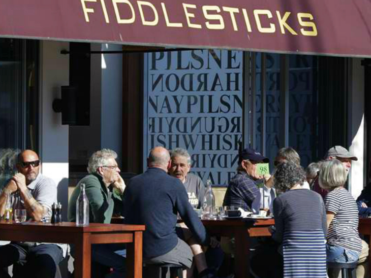 People sitting in a cafe in the city of Christchurch, New Zealand. According to a report, New Zealand's GDP declined 12.2% in the June quarter. In the wake of such an epidemic. (File)