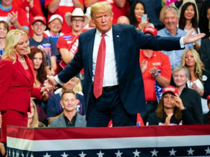 पिछले महीने मिनेसोटा में एक रैली के दौरान अमेरिकी राष्ट्रपति डोनाल्ड ट्रम्प। इस रैली में शामिल होने वाले 20 लोग पॉजिटिव पाए गए हैं।