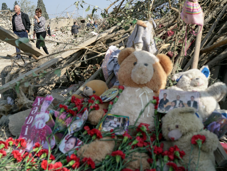 Teddy bears and photographs of children and people who died after a rocket attack on Saturday in the city of Ganja have been placed.