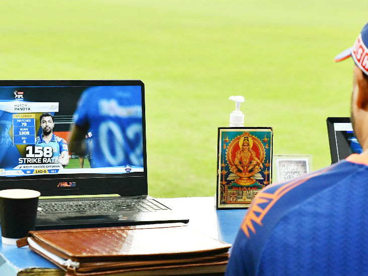 The Mumbai Indians dug-out featured a hand sanitizer and a picture of God.