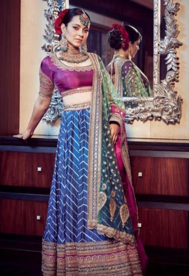 Kangana wore a purple and blue color lehenga.