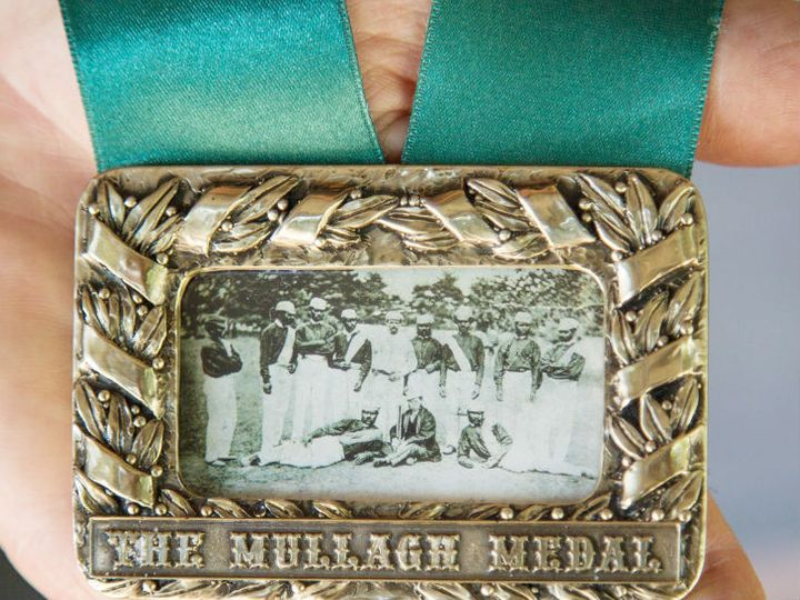 The photo of the Australian team going on a foreign tour for the first time in 1868 is on the medal.