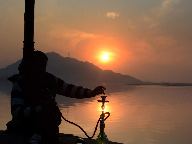 The photo is of Srinagar Dal Lake. Local citizens watching the sunset on the last day of the year here.
