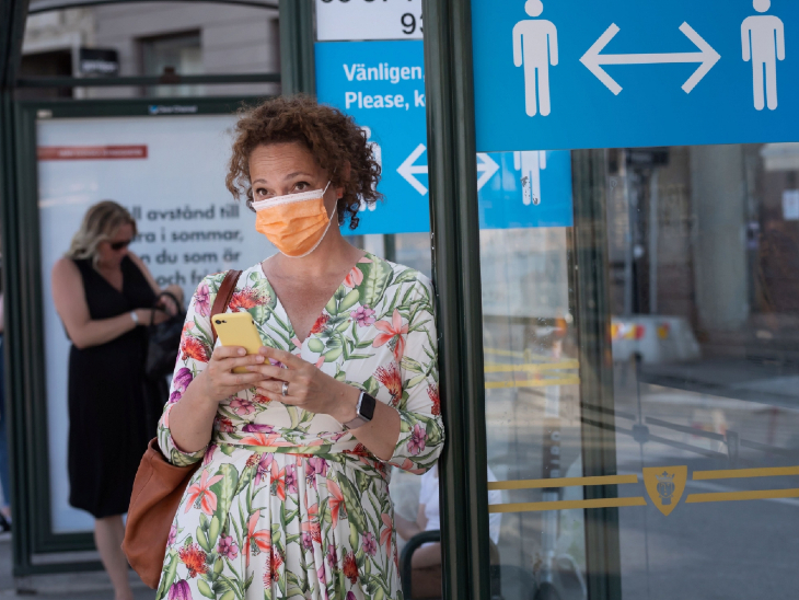 Women present at an airport in Sweden.  Here the government has decided to issue digital vaccine passports.  It will have the status of vaccination of passengers.