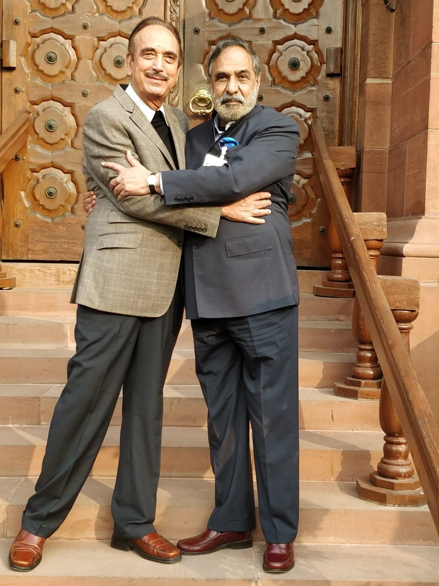 Outside Parliament House, Congress leader Anand Sharma (right) embraced Ghulam Nabi Azad and wished him good luck.