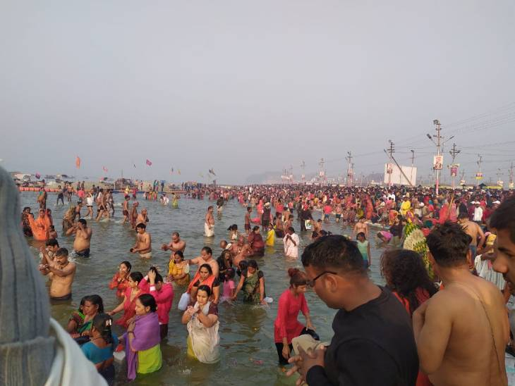 Devotees taking a bath in the Sangam.