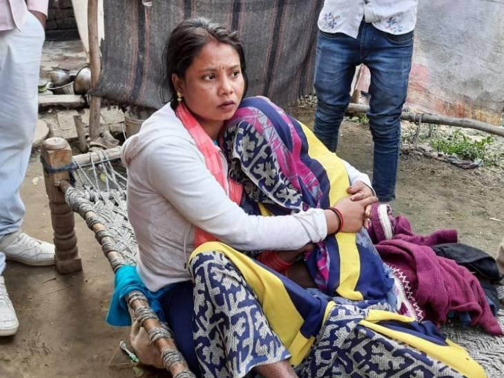 Kajal's mother in her relative's lap.