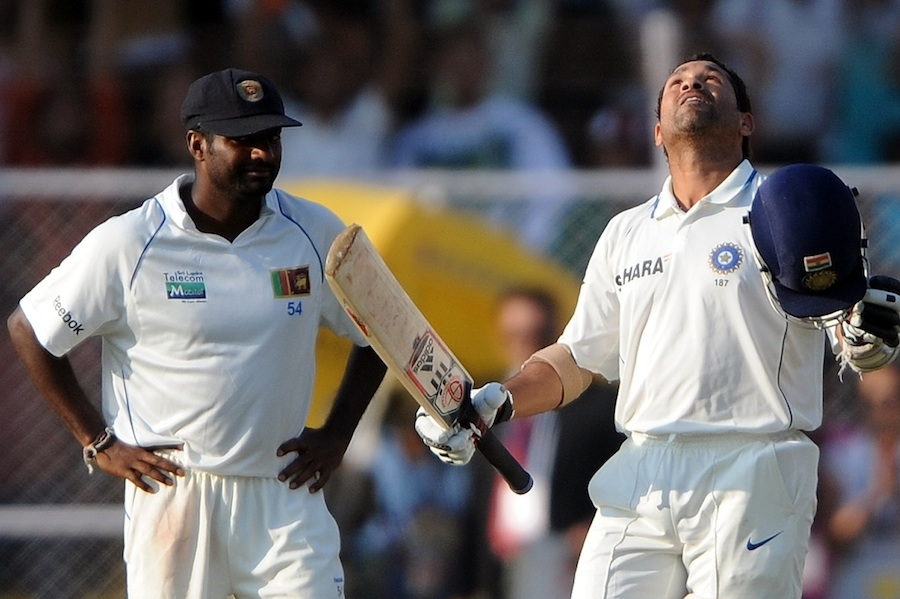 Sri Lankan great spinners Muttiah Muralitharan (left) and Sachin Tendulkar.  Sachin completed 30 thousand runs in international career against Sri Lanka in this test in November 2009.