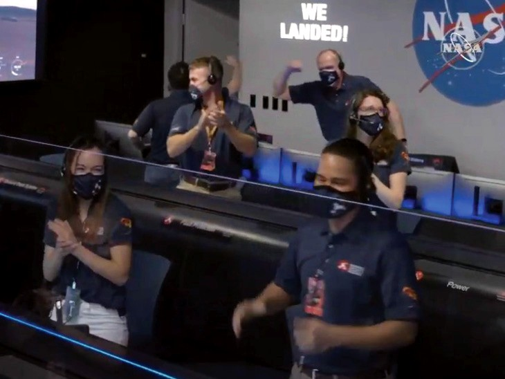 US Aeronautics and Space Administration team celebrating after successful landing.