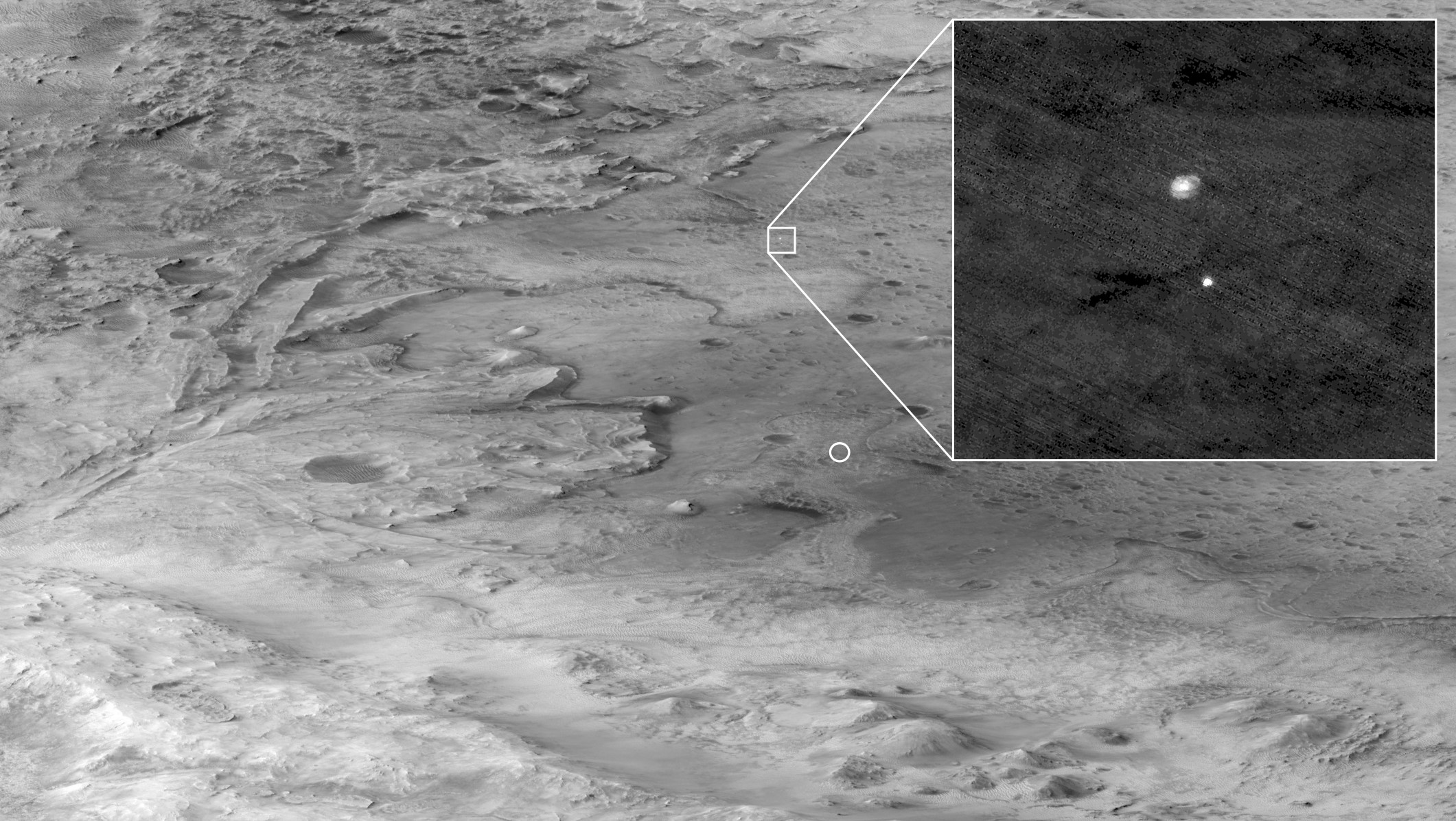 In this photo, a rover landing on the surface of Mars is seen through a parachute.  This is the most difficult stage during landing.
