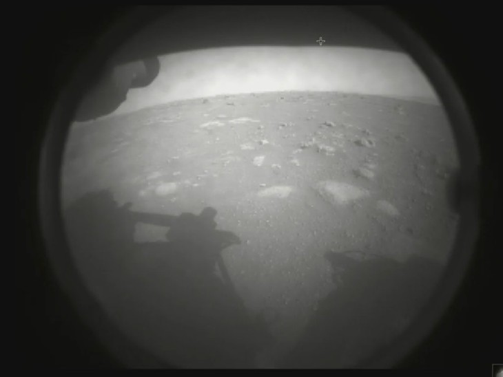 Rover sent this first photo to NASA.  Both the surface and the rover of Mars are visible in it.