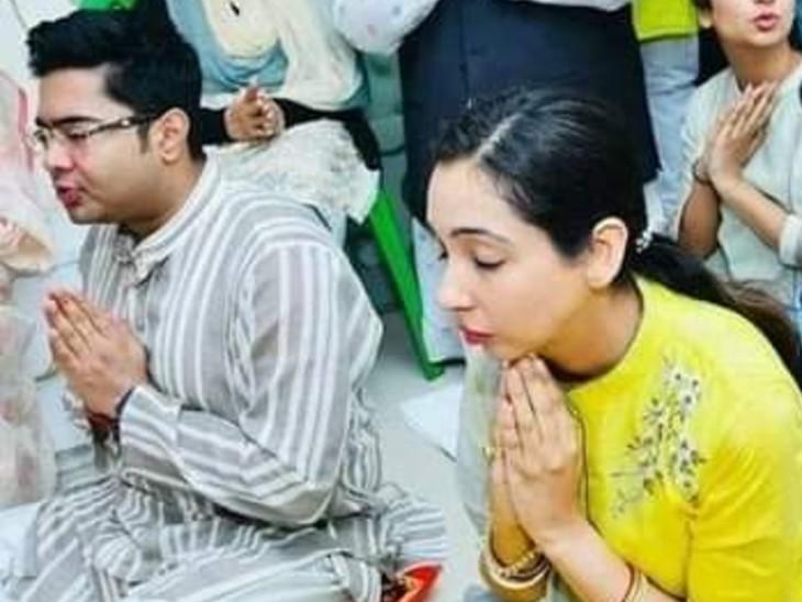 अभिषेक अपनी पत्नी रुजिरा के साथ पूजा करते हुए। रुजिरा कोयला घोटाले में आरोपी हैं।
