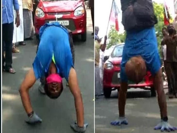 आरएसपुरम में AIADMK नेता के समर्थन में एक कार्यकर्ता ने सिर नीचे और पैर ऊपर कर कार खींचकर दिखाई।