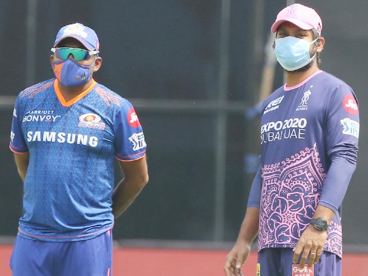 टॉस से पहले मुंबई इंडियंस के कोच महेला जयवर्धने और राजस्थान रॉयल्स के डायरेक्टर कुमार संगाकारा एक साथ नजर आए।