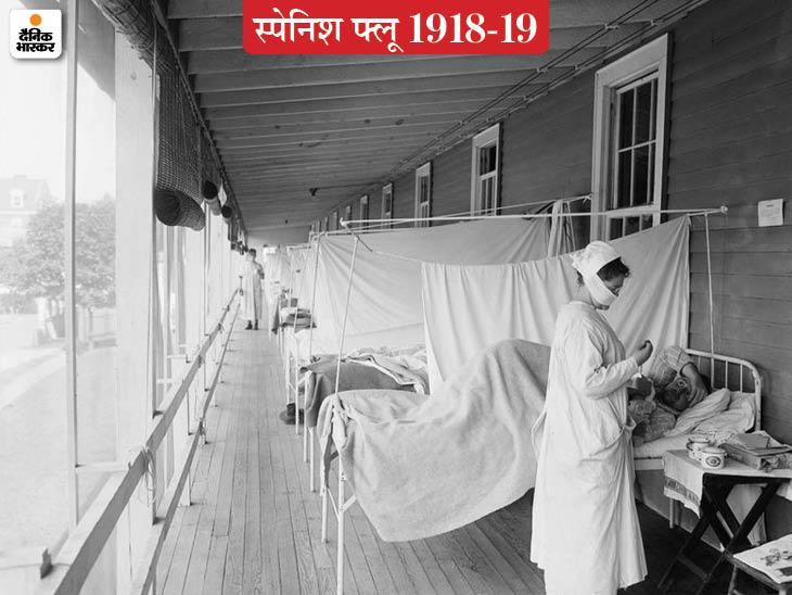 अमेरिका के मैरीलैंड में वाल्टर रीड सैन्य अस्पताल के फ्लू वार्ड में मरीज की जांच करती कपड़े का मास्क पहने एक नर्स।