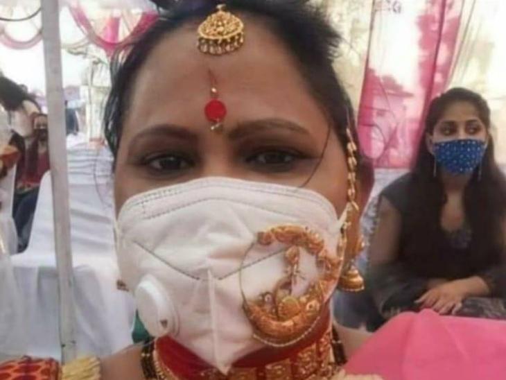 एक महिला की एन 95 मास्क के साथ सोने की नथ पहने फोटो हुई वायरल, शादी में शामिल होने के लिए पिंक साड़ी के साथ पहने ढेर सारे गहने|लाइफस्टाइल,Lifestyle - Dainik Bhaskar